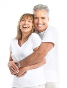 senior couple with dental crowns and bridge work