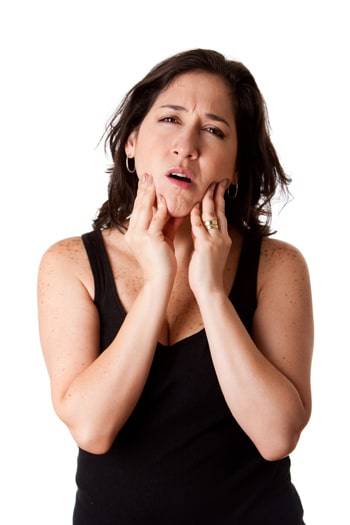 Woman with jaw pain feeling her lower jaw