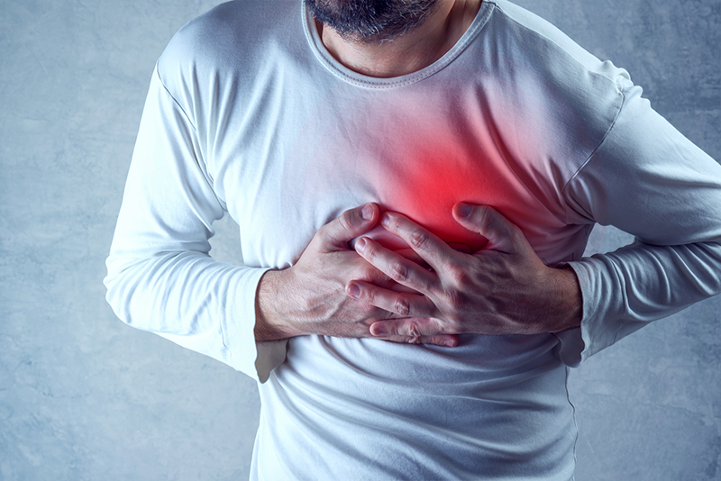 Man with chest pain grabs his heart