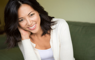 woman smiling sitting on couch