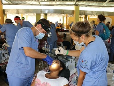 Dr. Taylor Rice performing dentistry