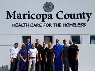 Rice Dentistry team members posing in front of the Maricopa County building, giving healthcare for the homeless