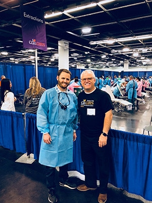 Dr Taylor & Scott Rice working at a free dental screening event