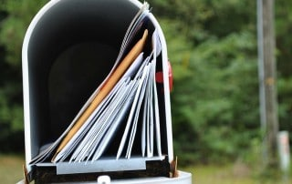 Mailbox sitting open with a full box waiting to be picked up - Mail order braces may be cheaper but it doesn't mean they are better