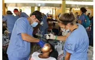 Dr. Taylor Rice of Rice Dentistry works on a patient while serving with Smile for Hope, a charity that provides dental care in remote villages in third word countries-min