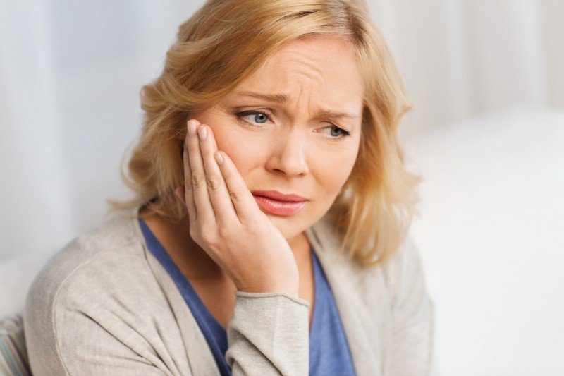 Why does my dental implant hurt?