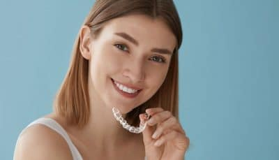 cute teen prepares to put in her Invisalign clear braces