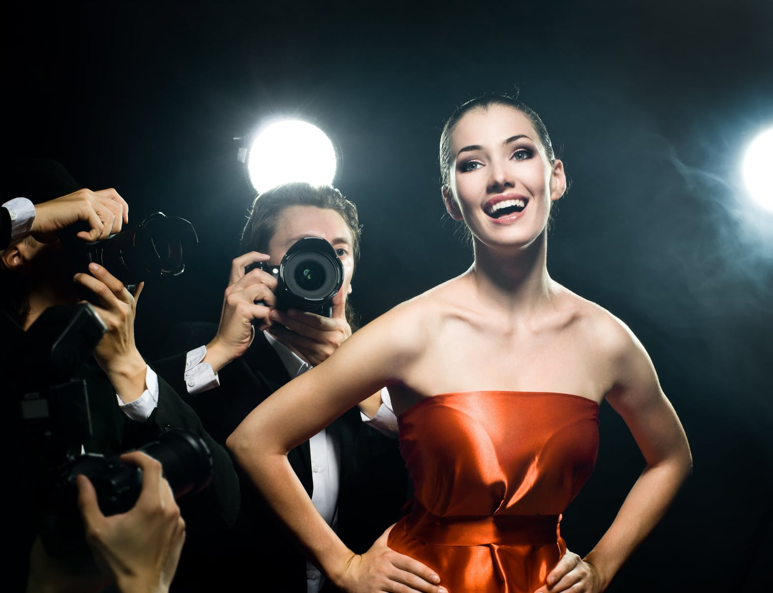 Photographers are taking a picture of a film star