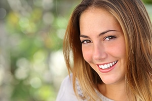 Beautiful young woman with a perfectly, whitened smile.