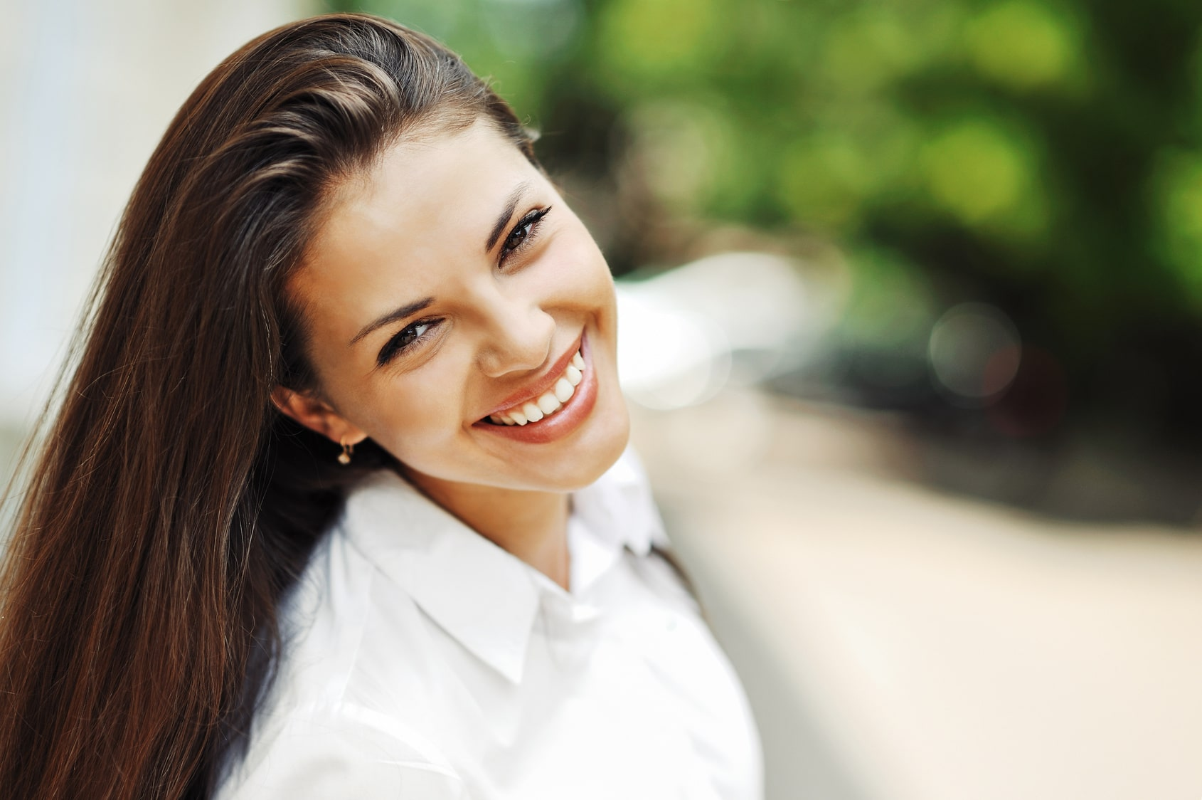 Beautiful and happy woman outside, smiling